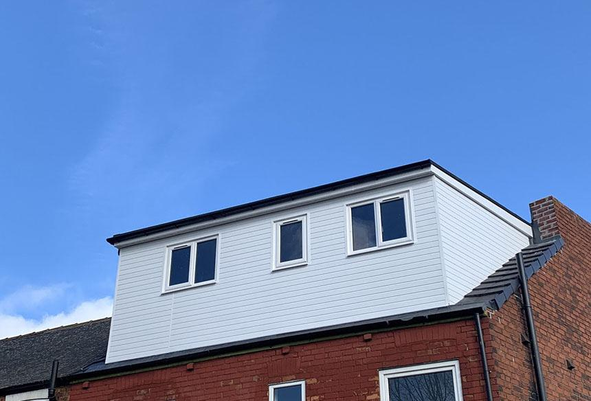 Loft conversion with white walls from outside