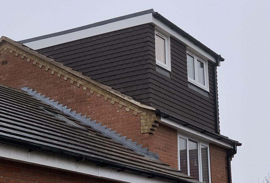 Loft conversion with brown walls from the outside