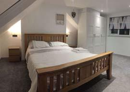 Loft conversion into a bedroom with double bed
