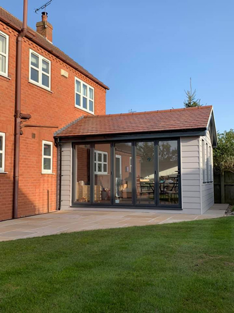 Outdoors conservatory conversion